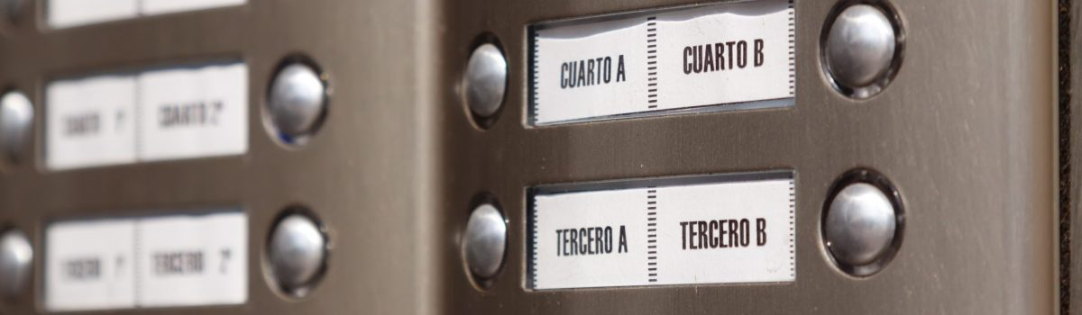 Close-up of building intercom. Numbers in Spanish